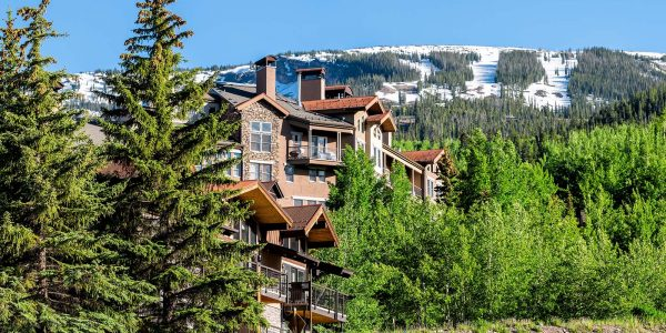 Aspen Snowmass village town houses on hill in Colorado dummer with snow mountain